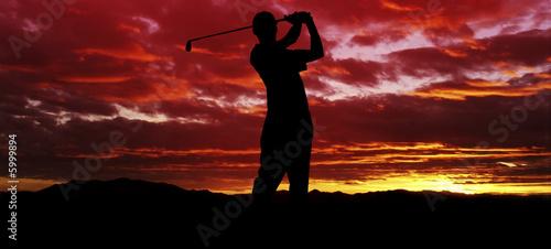 Spoed Foto op Canvas Vuurtoren Sunset Golf Swing