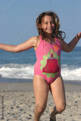 Little Girl Jumping At The Beach Buy This Stock Photo