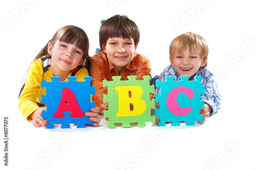 Children with Alphabet Puzzle #6077075