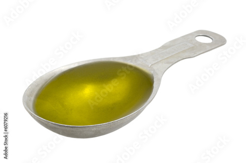 Fototapeta Measuring tablespoon of olive oil isolated on white