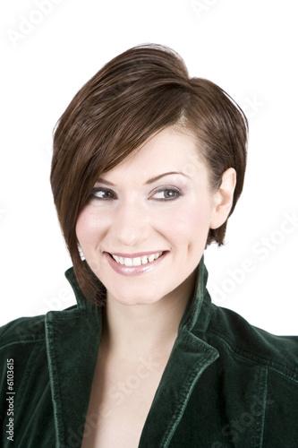 Valokuva  Beautiful Brunette In Green Smiling