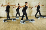 A group of women exercising with dumbbells in the fitness club.