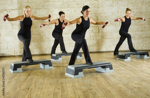 A group of women exercising with dumbbells in the fitness club. Wallpaper Mural