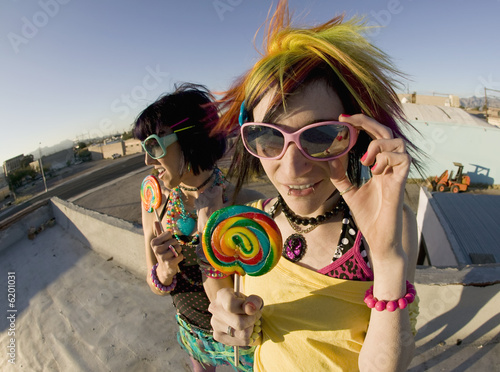 Fotografie, Obraz  Fisheye shot of girls in brightly colored clothing on a roof