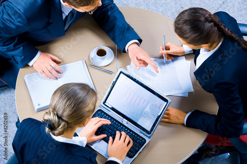 Image of three business people working at meeting Fototapet