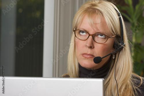 Fotografie, Obraz  Bored Businesswoman on Telephone Headset