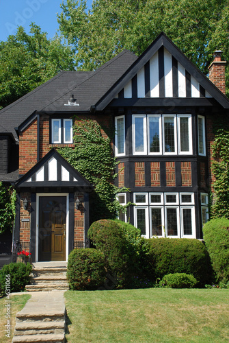 Small Tudor Style House With Black And White Trim
