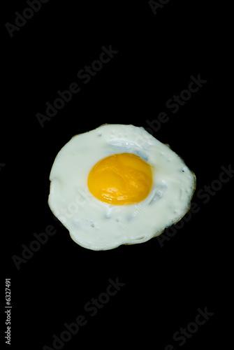 Deurstickers Gebakken Eieren fried eggs on background black