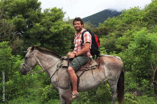 Foto auf Gartenposter Reiten Man horseback riding in Central America