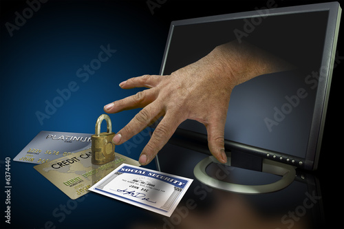 Fotografie, Obraz  Identity theft on the web with credit cards and social security