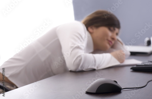 Fototapety, obrazy: Beautifull business woman tired at work