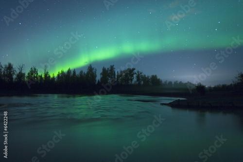 Photo  Aurora Borealis over the river
