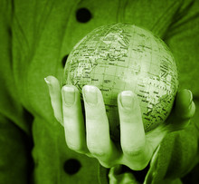 Globe In A Girl's Hands. Macro Image
