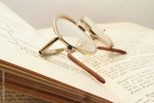 Photo Pice of book and brown glasses