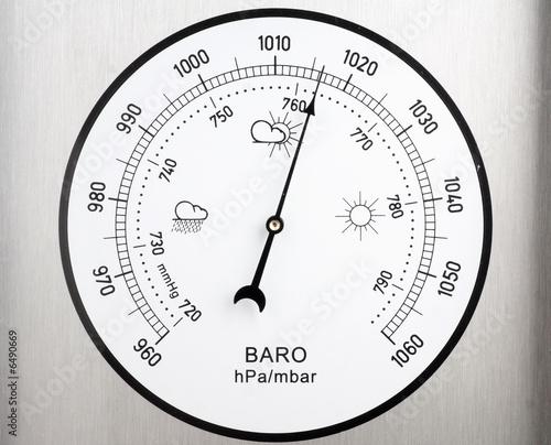 Photo circular barometer, indicating unstable weather