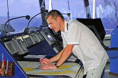 Fotografía  Navigation officer works with a navigation chart