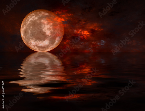 Full moon raising over water