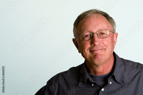 Fotografie, Obraz  Portrait of Friendly, Mature Man with isolated white background