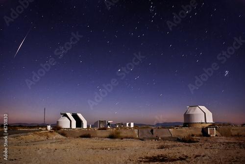 Iridium Flare above telescopes - Buy this stock photo and