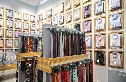 Fotografering shirts and neckties in shop