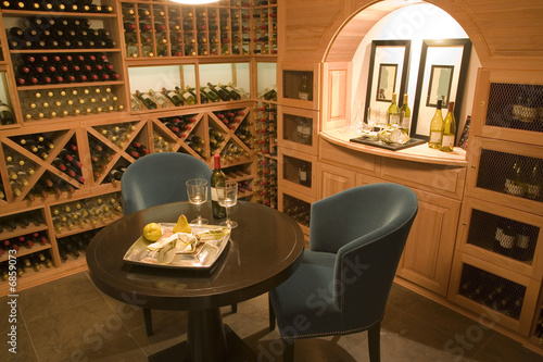 Wine cellar with seating for two. Wallpaper Mural