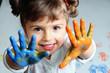 Leinwandbild Motiv Little girl playing with colors