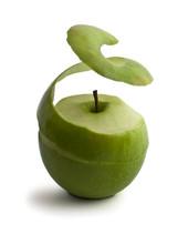 Green Peeled Apple. Peel Levitates Showing Pulp