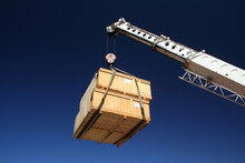 Wooden Crates Being Moved By Crane.