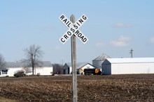 Railroad Crossing Sign In The Countryside