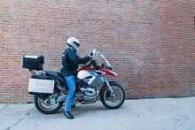 Man On Motorcycle Reading Roadmap