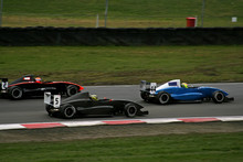 Race Cars On Track Racing At High Speeds