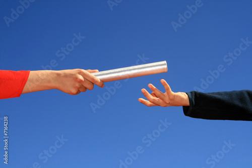 hands passing baton Fototapet