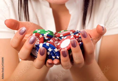 girls hands holding a bunch of poker chips (focus on front) Canvas Print