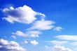 Leinwandbild Motiv Wolken am blauen Himmel