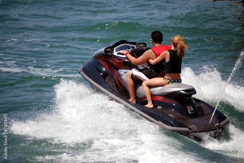 Poster Water Motor sports Young Couple on a Black Jetski