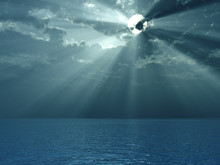 Solar Beams Breaking Through Clouds Above Ocean