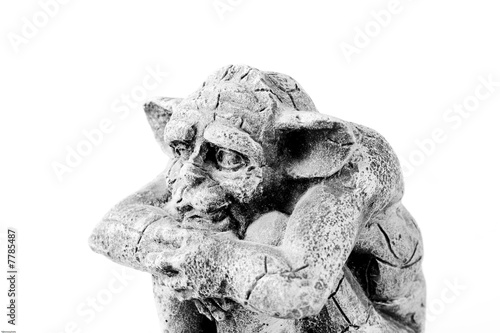 Photo  sitting troll from the side