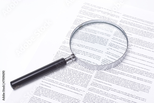 Fototapeta Magnifying glass lying on a legal contract obraz