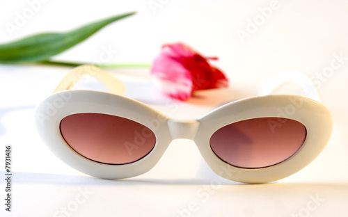 white plastic sunglasses and tulip Wallpaper Mural