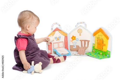 Baby girl with toy book