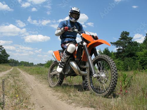 Photo raider sitting on the motocross bike
