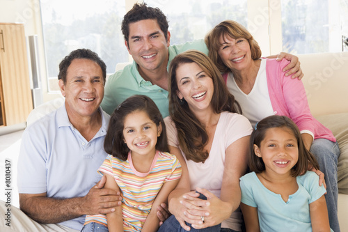 Photo  Extended family in living room smiling