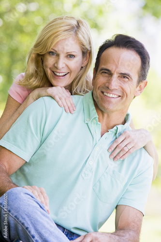 Poster  Couple outdoors smiling