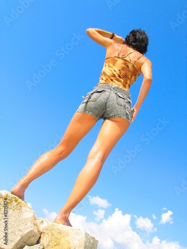 Young cute girl in the sky. Summertime Wallpaper Mural