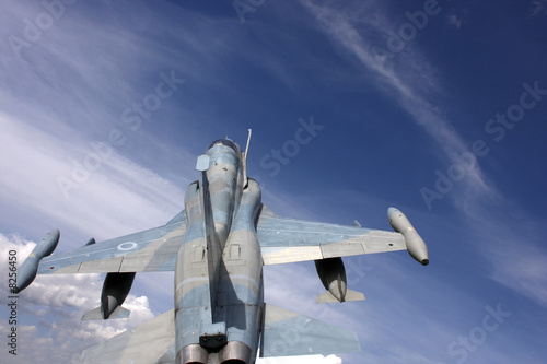 Fighter jet in sky background Fototapete