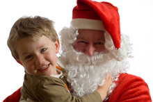 Father Christmas And Young Boy