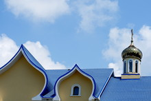 Blue Roof Of Church Against The Sky Background