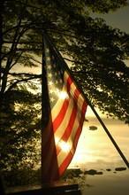 Sun Sets Behind American Flag