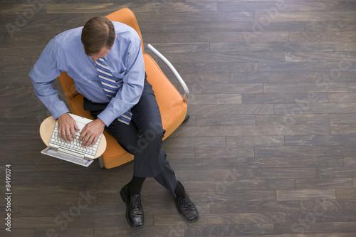 Obraz Businessman sitting with laptop - fototapety do salonu