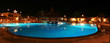 Luxury swimming pool at night